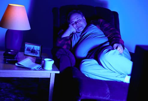 Man Sleeping In Front of the TV