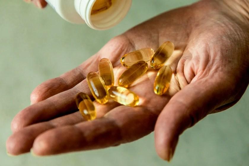 Handful gold capsules