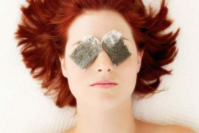 photo of tea bags on eyes
