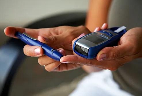 woman checking glucose