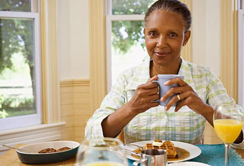 Smiling Woman Eating Healthy Breakfast