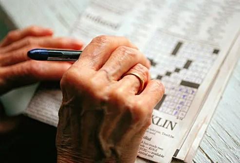 senior woman doing crossword