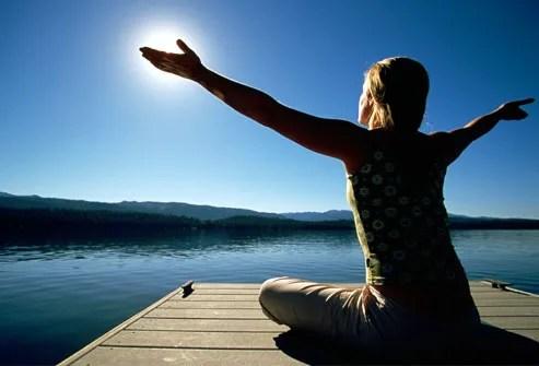 Woman Doing Yoga on Dock