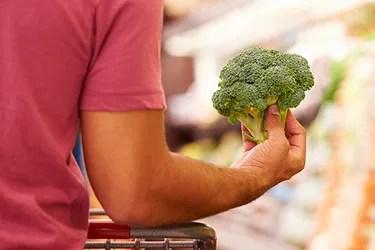 man shopping for broccoli