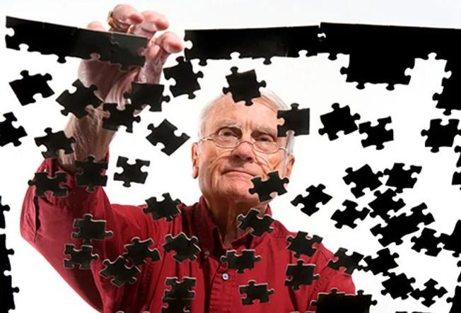 man solving puzzle