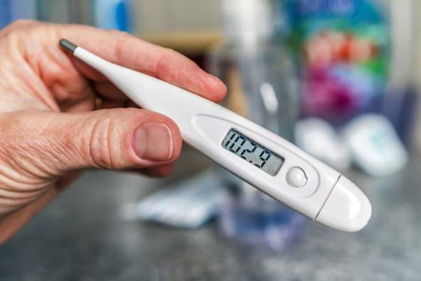 photo of thermometer showing high fever