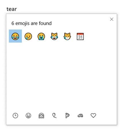 Вставить смайлик со слезами радости в Windows