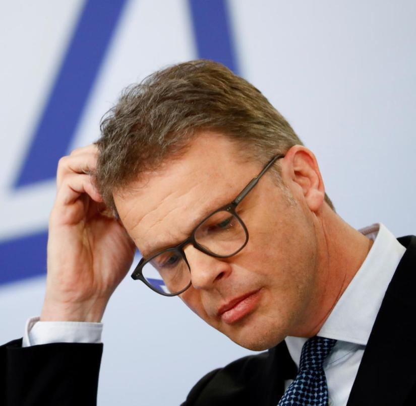 FILE PHOTO: Christian Sewing, CEO of Deutsche Bank AG, addresses the media during the bank's annual news conference in Frankfurt