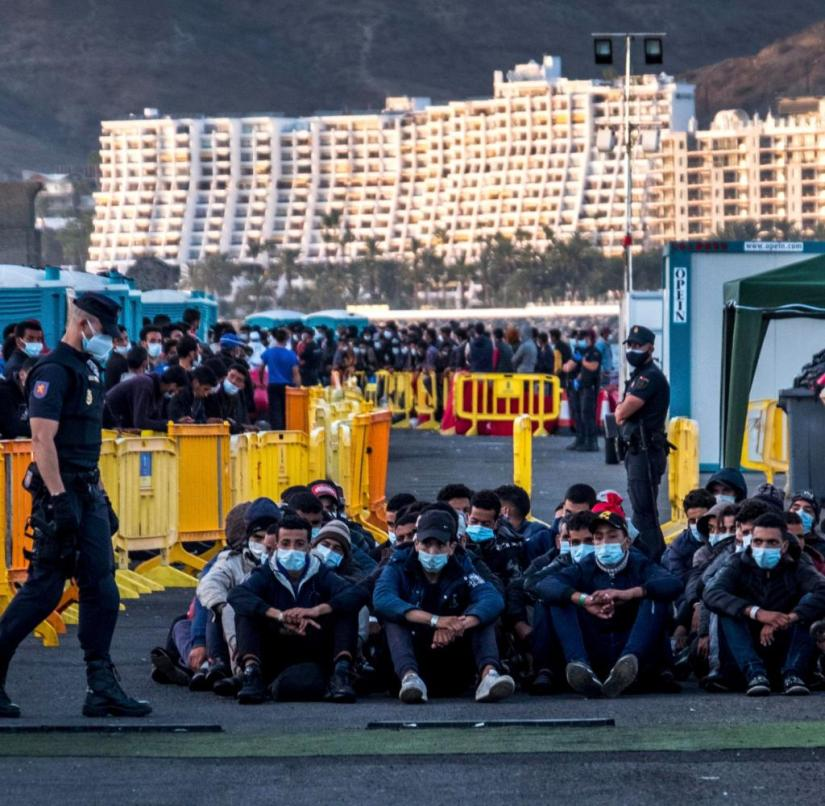 Refugees in the port of Arguineguin on Gran Canaria