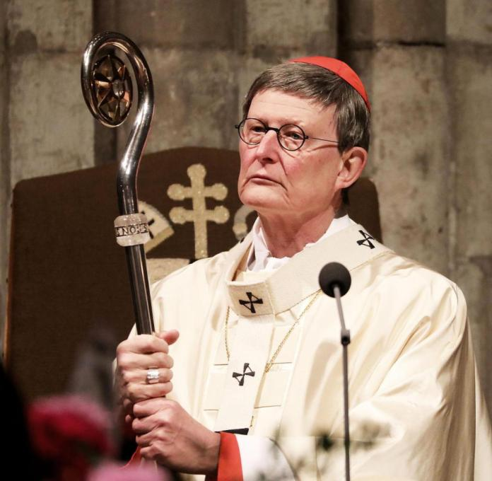"""At a church service in Cologne, Cardinal Woelki looked downright relaxed.  """"The promise and the promise is: God abides with us,"""" he said"""