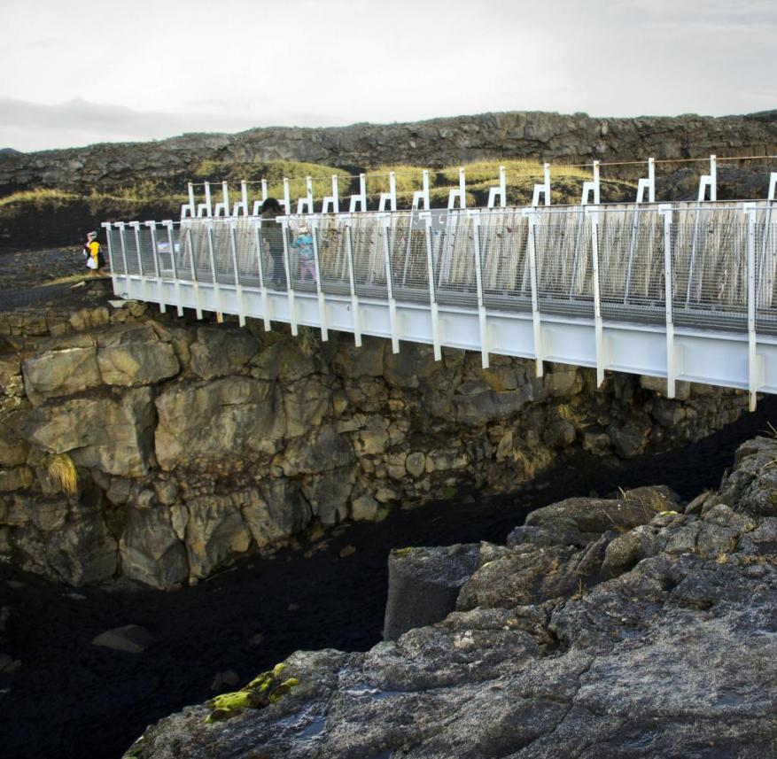 Iceland: The bridge between the Eurasian and American continental plates spans a 15 meter wide lava canyon