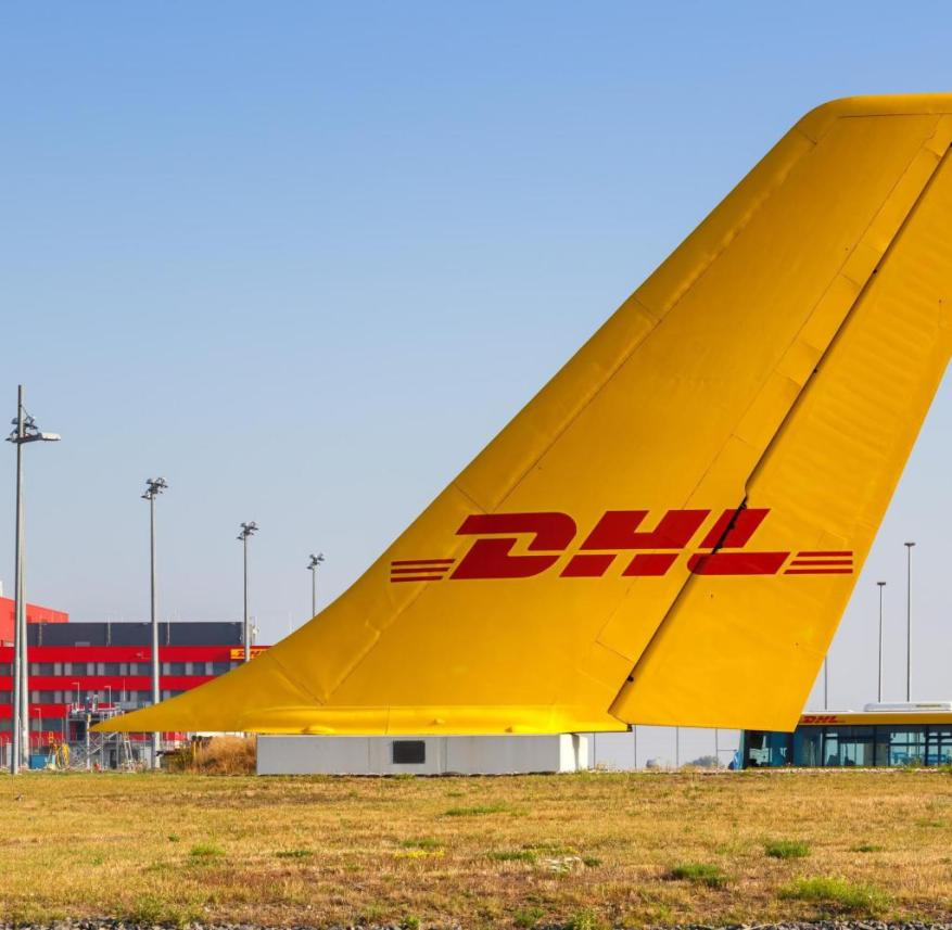 Leipzig, Germany - August 19, 2020: DHL Hub Leipzig Halle Airport LEJ Airport aircraft vertical stabilizer in Germany.  |  Usage worldwide