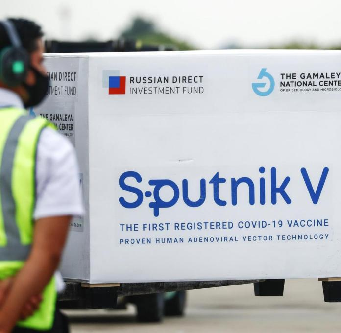 BUENOS AIRES, ARGENTINA - JANUARY 28: A container is transported through the runway after being unloaded from an Airbus 330-200 of Aerolineas Argentinas at Ministro Pistarini International Airport carrying the third batch of Sputnik V vaccines from Russia on January 28, 2021 in Buenos Aires, Argentina. According to official reports, the shipment contains 220,000 doses for Argentina and an extra batch of 6,000 that will be delivered to Bolivia. (Photo by Marcos Brindicci/Getty Images) Getty ImagesGetty Images