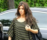 Kourtney Kardashian Defends Decision to Dye Her Hair While