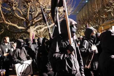 February 1, 2017 - Berkeley, California, U.S - Anti-fascist protesters dressed in black arrive at a protest on the University of California-Berkeley campus against Milo Yiannopoulos, a Breitbart writer who has grown notorious for his comments targeting women and minorities. Yiannopoulos was scheduled to speak Feb. 1 at the invitation of College Republicans but he left the campus an hour-and-a-half before his scheduled talk as protesters grew unruly, throwing objects and setting off a bonfire