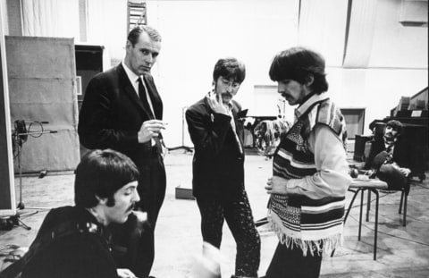 March 31, 1967 - London, United Kingdom - The new look Beatles seen here during a recording session at the E.M.I. studios..They are recording their latest album ''Sergeant Pepper's Lonely Hearts Club Band''..Left to Right Paul McCartney, Musical Director George Martin, John Lennon, George Harrison and (Background) Ringo Starr.