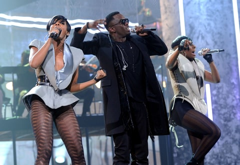 Rapper Sean 'Diddy' Combs (C) with Dawn Richard (L) and Kalenna Harper from the musical group Dirty Money perform onstage during the 2010 American Music Awards held at Nokia Theatre L.A. Live on November 21, 2010 in Los Angeles, California.