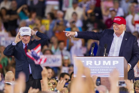 U.S. Republican presidential candidate Donald Trump introduces Alabama Senator Jeff Sessions (R) Mobile during his rally at Ladd-Peebles Stadium on August 21, 2015 in Mobile, Alabama. The Donald Trump campaign moved tonight's rally to a larger stadium to accommodate demand.