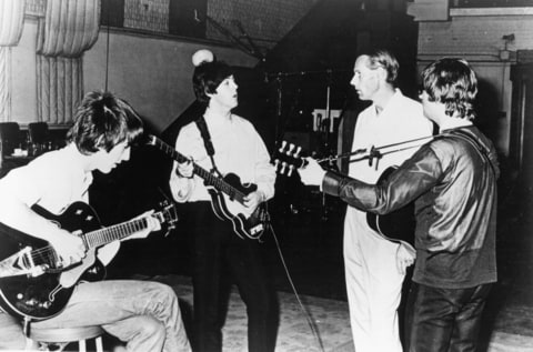 Rock and roll band 'The Beatles' pose for a portrait in the studio with their producer George Martin in cicra 1964.
