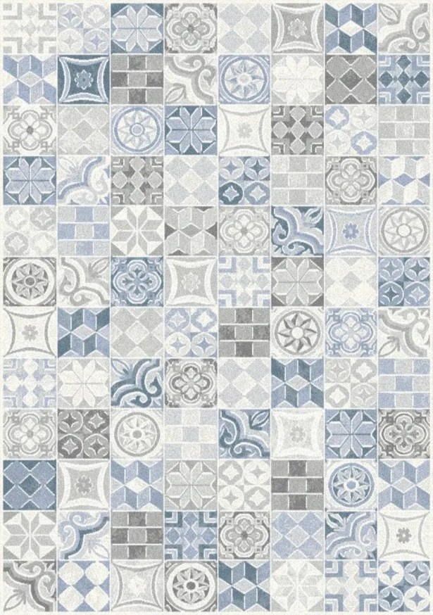 Montgomery Quilted Symbols Blue/Cream Area Rug Rug Size: 7'10