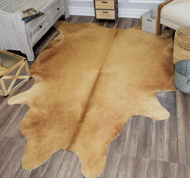 Sarah Hand-Woven Cowhide Brown Area Rug Rug Size: 5' x 6'6