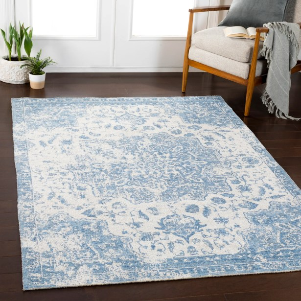 Tybalt Distressed Vintage Blue/Ivory Area Rug Rug Size: Rectangle 7'10