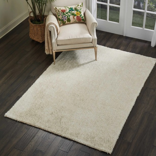 Sinechra Hand Tufted Ivory Area Rug Rug Size: Rectangle 7'6