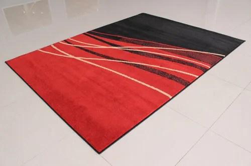 Black/Orange Area Rug Rug Size: 7'11