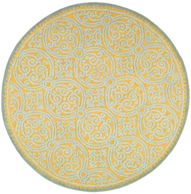 Charlenne Hand-Tufted Blue/Gold Area Rug Rug Size: Round 4'