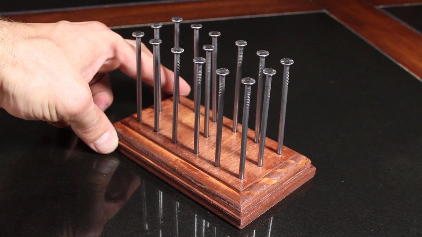How Do You Balance 14 Nails On A Single Nailhead Find Out