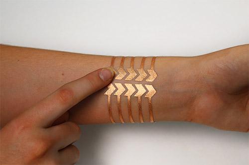 Ученые придумали умную татуировку