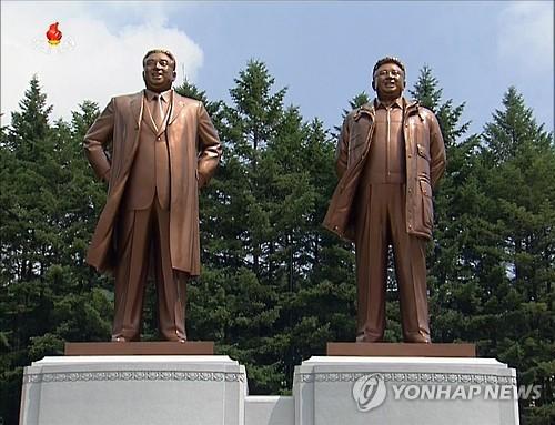 N. Korea unveils statues of former leaders