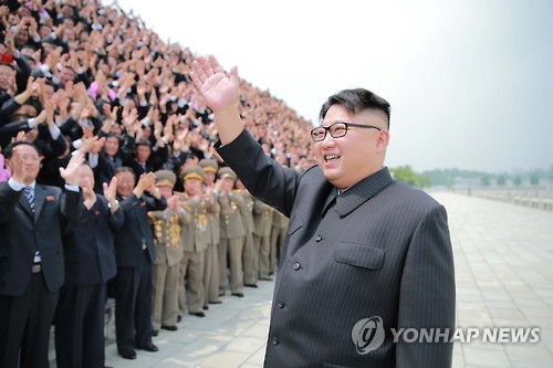 N.K. leader celebrates missile launch