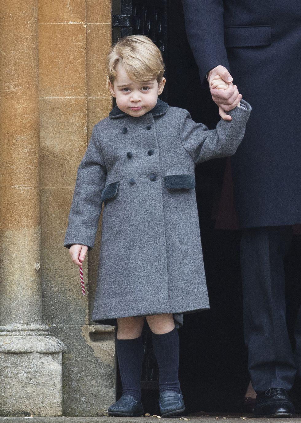 الأمير جورج فى معطف رمادى