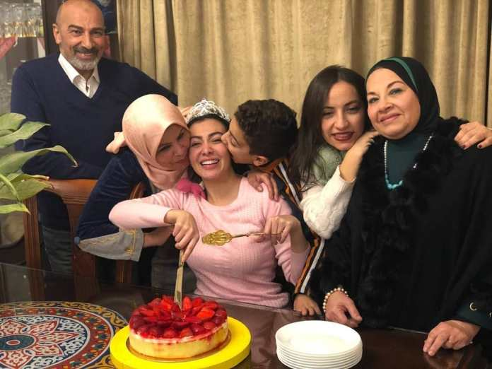 Mirhan with her family