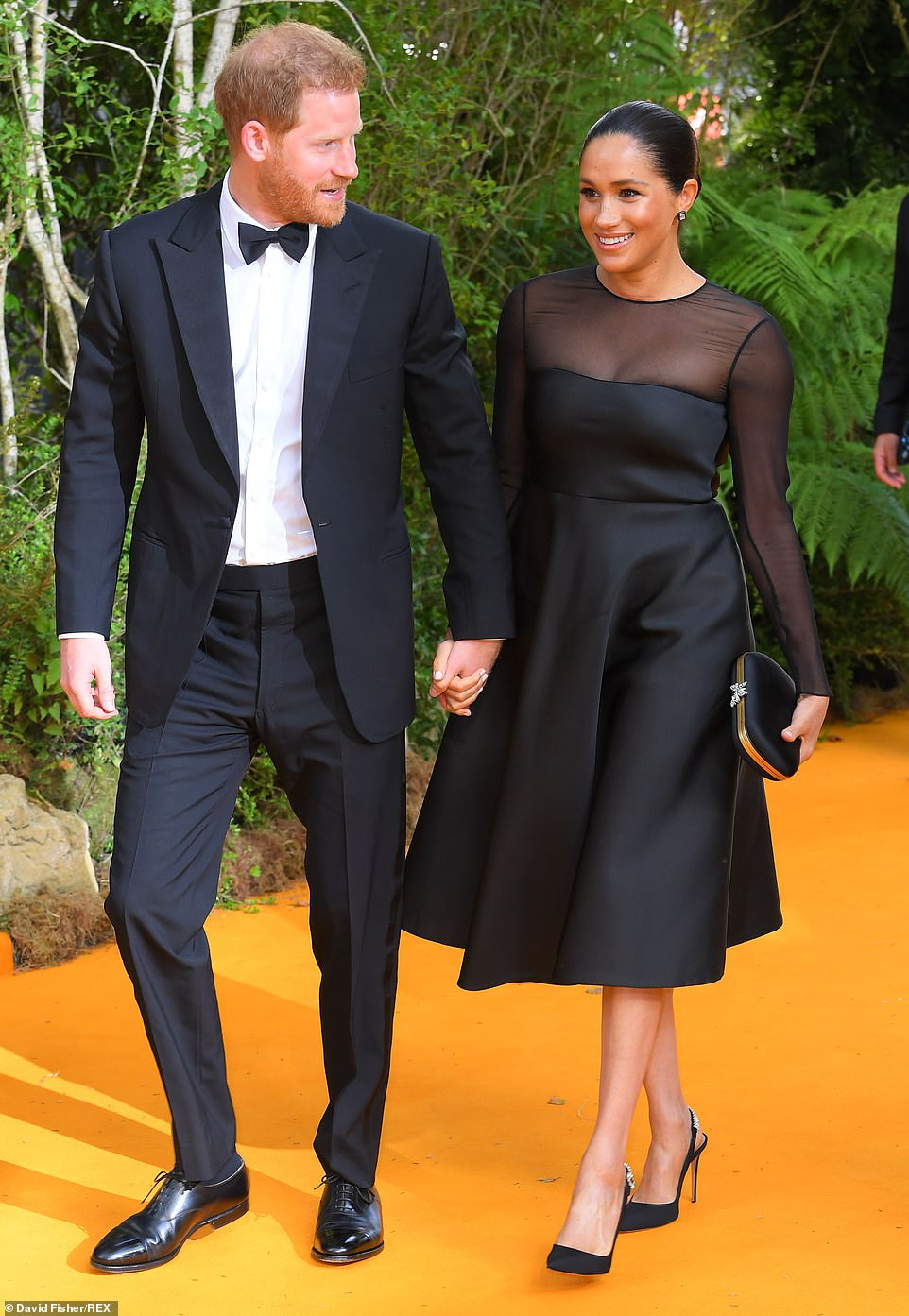 16040544-7246349-Sophisticated_Meghan_donned_a_stunning_3_454_mid_length_black_go-m-246_1563131169805