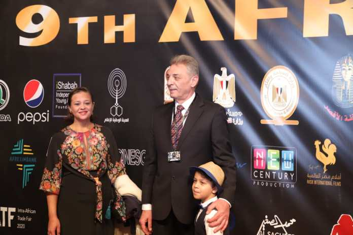 Artist Mahmoud Hamida, his wife and son during their participation in the festival