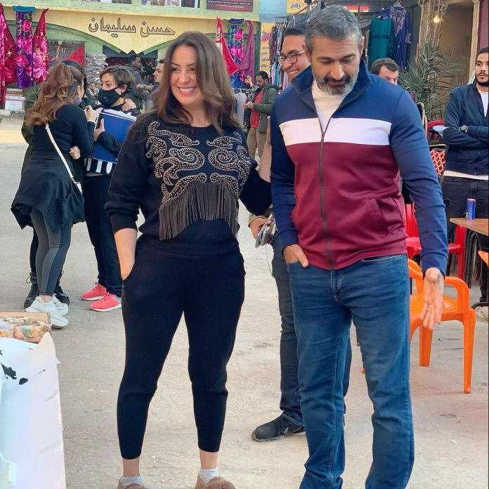 Yasser Jalal and Nermin El-Feki in the shadow of a man