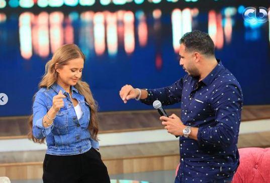 Nelly Karim dancing with Ramy Ashour