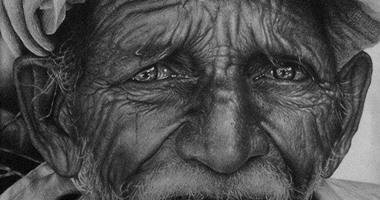 بالصور فنان تشكيلى يجسد قسوة الحياة على وجوه البشر فى