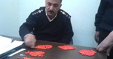 """بالصور.. إحباط تهريب 750 قرصا مخدرا داخل """"علبة سمن"""" بمطار برج العرب"""