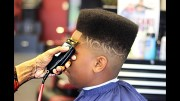 juice haircut with design fade