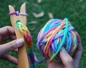 wooden knitting fork with hand painted rainbow wool - indigoinspirations