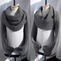 Bolero sweater scarf shawl with sleeves at both ends in grey.