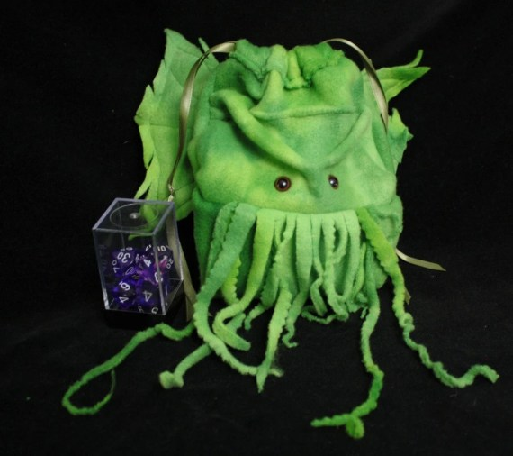 large Cthulhu drawstring dice bag- Wristlet Purse- for Lovecraft fans- Dungeons and Dragons dice or Warhammer miniatures/ My Funky Camelot ◅ ▻ large Cthulhu drawstring dice bag- Wristlet Purse- for Lovecraft fans- Dungeons and Dragons dice or Warhammer miniatures/ My Funky Camelot large Cthulhu drawstring dice bag- Wristlet Purse- for Lovecraft fans- Dungeons and Dragons dice or Warhammer miniatures/ My Funky Camelot large Cthulhu drawstring dice bag- Wristlet Purse- for Lovecraft fans- Dungeons and Dragons dice or Warhammer miniatures/ My Funky Camelot large Cthulhu drawstring dice bag- Wristlet Purse- for Lovecraft fans- Dungeons and Dragons dice or Warhammer miniatures/ My Funky Camelot large Cthulhu drawstring dice bag- Wristlet Purse- for Lovecraft fans- Dungeons and Dragons dice or Warhammer miniatures/ My Funky Camelot 🔎zoom Request a custom order and have something made just for you. Item Details 4 out of 5 stars. (820) reviews Shipping & Policies This adorable dude is a drawstring pouch Cthulhu, great for Lovecraft fans! Use it for Dungeons and Dragons dice or Warhammer miniatures, as well as Cameras, hand held video games, card game storage, or even a wristlet purse! You name it! I use this awesome super-soft super-nice smooth polarfleece in tie-dye greens with brown safety eyes. I use green satin ribbon for drawstrings roughly 7