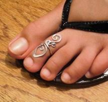 Women Toe Ring Tattoos Designs