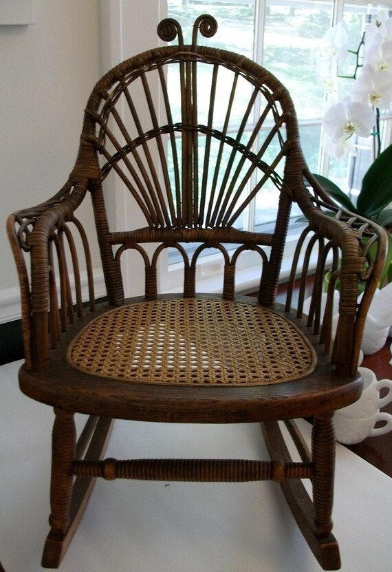 VINTAGEANTIQUE CHILDRENS ROCKING CHAIR WITH CANED SEAT