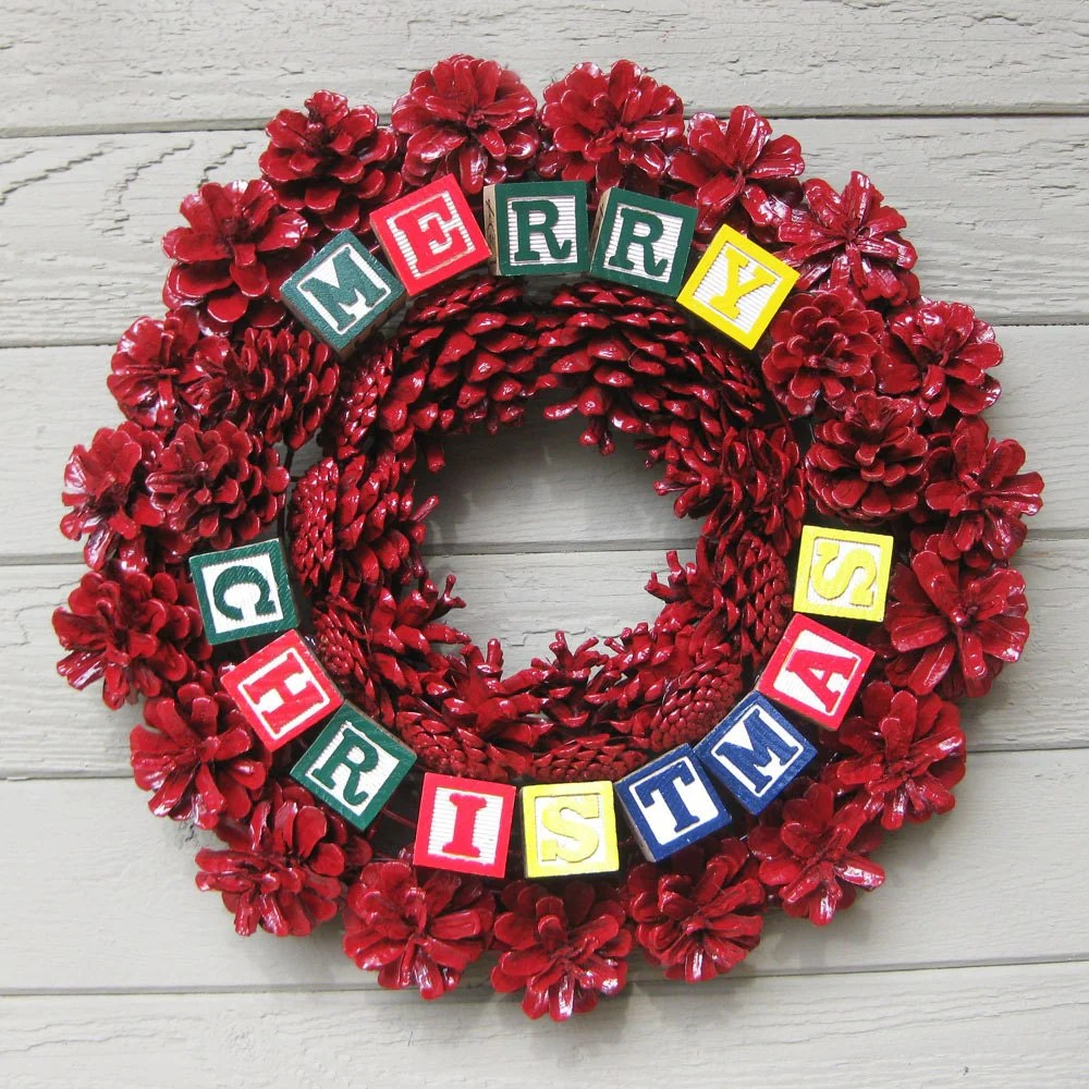 Red Pine Cone Wreath Alphabet Blocks Merry Christmas Front