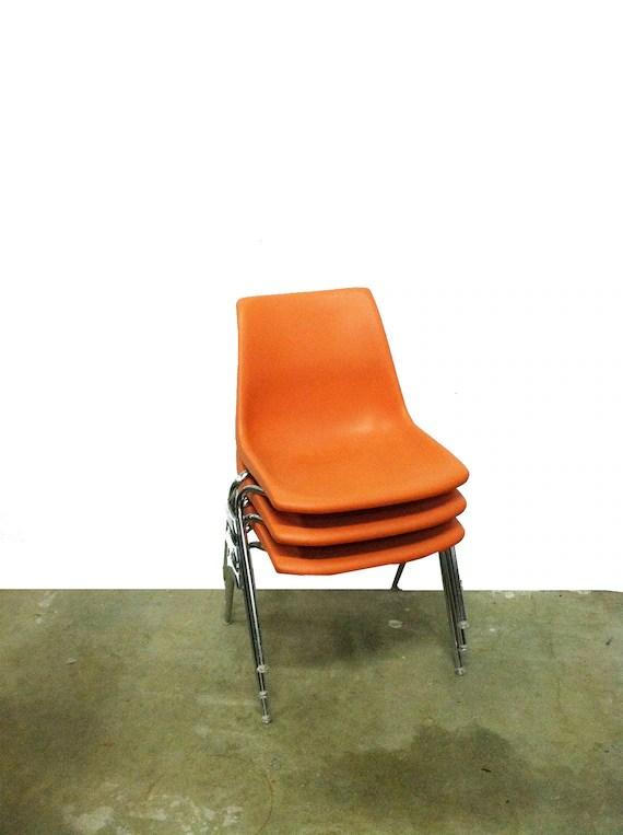 Three Stackable Vintage Orange Krueger Chairs