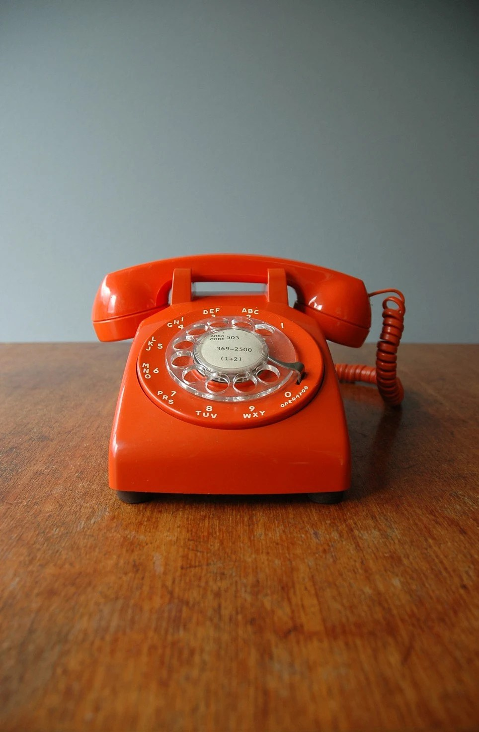 Reserved for kuenchang 1970s Mod Orange Rotary Phone